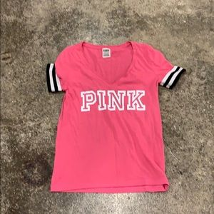 Pink vneck top with black and white sleeves XS